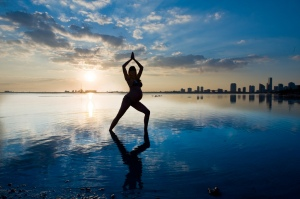 Pregnant yoga on the beach 4495406433_45030db1e5_b