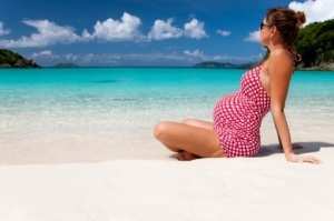 pregnant woman sunbathing at a Caribbean beach