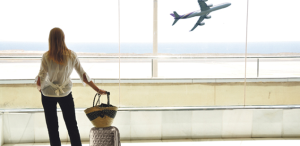 Woman airport luggage Header_Samsonite2013