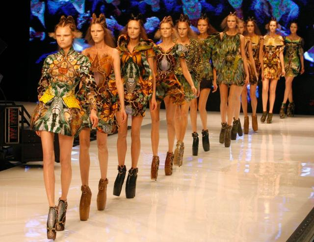 Models present creationby British fashion designer Alexander McQueen for his Ready to Wear Spring Summer 2010 fashion collection, presented in Paris, Tuesday Oct. 6, 2009. (AP Photo/Michel Euler) France Fashion